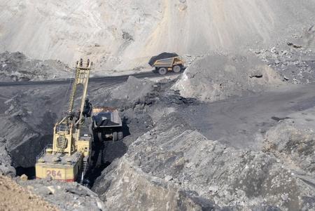 buryatia: TUGNUI, RUSSIA - APRIL 2: The opening of Tugnuiskaya coal-preparation plant.  A mining shovel puts coal into a hauler, April, 2, 2008 in Tugnui, Buryatia, Russia.