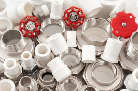 many combined fittings for metal and PVC pipes, unions and valves photo