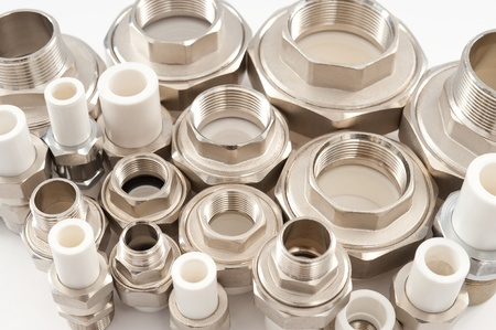 many combined fittings for metal and PVC pipes photo