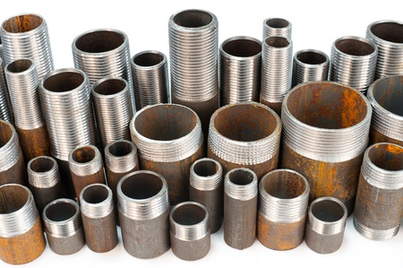 screw jack: a lot of short metal pipes with external thread, of different caliber Stock Photo