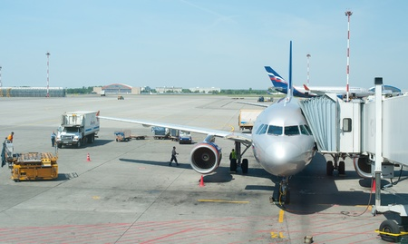 lets: MOSCOW, RUSSIA - MAY 28: An airplane of Aeroflot lets passengers off at one of Sheremetyevo