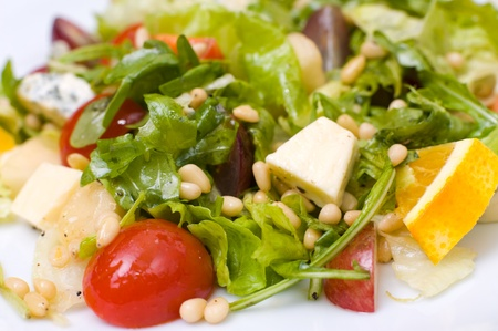 Caesar salad with pine nuts and musty cheese photo