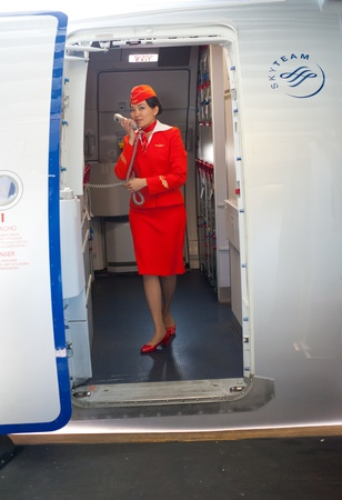 constraint: IRKUTSK - MOSCOW, RUSSIA - MAY 28: An unidentified air hostess of the airline Aeroflot announces on board of the flight from Irkutsk to Moscow, May 28, 2011, Irkutsk - Moscow, Russia. Editorial