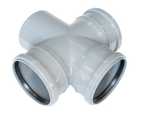 a PVC fitting - a draining four way union photo