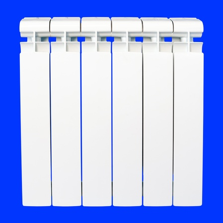 bimetallic: a bimetallic radiator, isolated over blue, clipping path Stock Photo