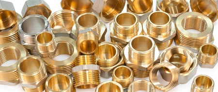 many metal fittings - pipe unions, bushings, bullnoses and nuts photo