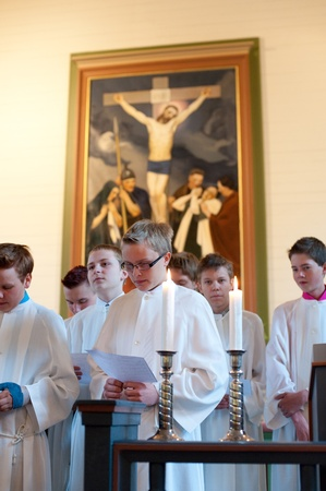 confirmed: VALTIMO, FINLAND - JUNE 19: Fourteen young girls and boys of age 15 are confirmed at the Valtimo Lutheran Church on June, 19, 2011 in Valtimo, Finland. Young participants sing a hymn.