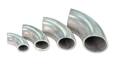knees bent: some galvanized iron pipe bends - spare parts for pipelines