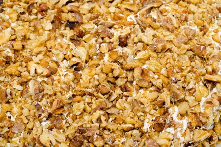 cake topping: crushed walnuts on cream - cake topping, closeup Stock Photo