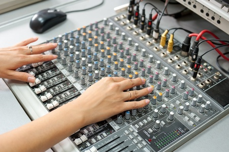 jackplug: female hands at a sound mixing console