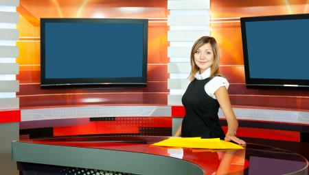 a pregnant television anchorwoman at a TV studio Stock Photo