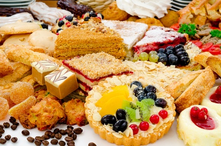 many different kinds of dessert - cakes, sweets and pies photo