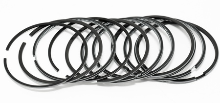 some piston rings - spare parts for a diesel engine photo