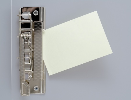clamps: a small blank sheet of note paper in a clip file