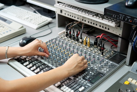 female hands at a sound mixing console Stock Photo - 11049332