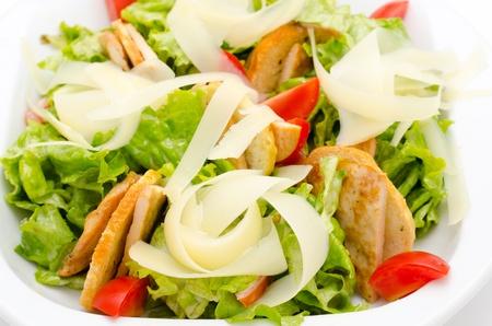 caesar salad: fresh Caesar salad with ham and tomatoes