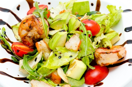 roquette: salad - avocado, shrimps, roquette, lettuce and tomatoes Stock Photo