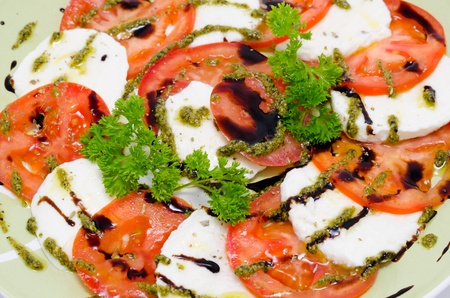 tomato and feta cheese circles seasoned with garlic and soy sauces photo