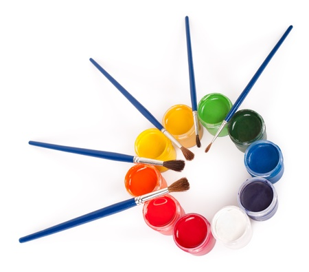 some: gouache paints pots and brushes arranged into a circle