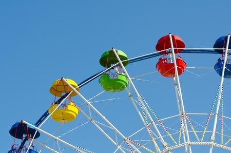 a ferris wheel in blue sky - horizontal shot, copy space Stock Photo