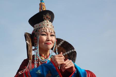 folk dancing: ULAN-UDE, RUSSIA - SEPTEMBER 17: Unidentified dancer of Baikal, State Buryat song and dance company, perform in show of Amarhuu Borhuu, popular singer, September 17, 2006, Ulan-Ude, Buryatia, Russia. Editorial