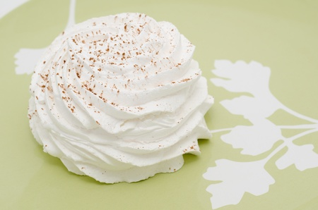 strew: a white meringue dusted with cocoa powder