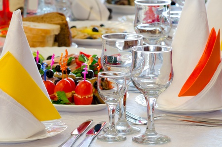 place setting at a laid restaurant banquet table photo