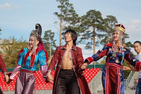 ULAN-UDE, RUSSIA - SEPTEMBER 17: Artists of Baikal, the State Buryat song and dance company, perform in a show of Amarhuu Borhuu, a popular singer, September 17, 2006 in Ulan-Ude, Buryatia, Russia. Stock Photo - 11305490
