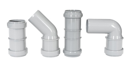 four different PVC fittings - draining straight and elbow pipes photo