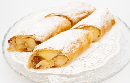 flaky: fresh flaky Swiss rolls - sweet filling of apples, bananas and strawberries Stock Photo