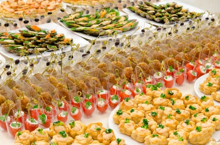 a lot of cold snacks on buffet table, catering Stock Photo - 11569350