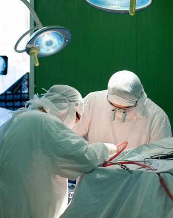 a real brain surgery, two surgeons at work