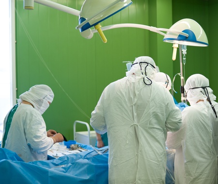 a real surgical operation in a green room Stock Photo - 11564947