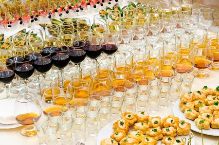 half fish: a lot of alcohol drinks on buffet table, catering