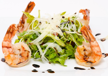 shallow focus: salad - shrimps, fresh roquette and grated cheese Stock Photo
