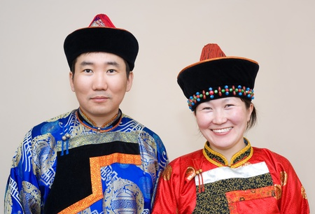 national costume: a Buryat (Mongolian) young couple, a husband and a wife  Stock Photo
