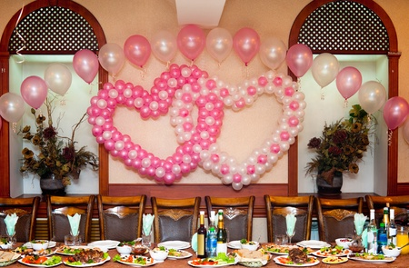 a wedding banquet table - balloons hearts above Stock Photo