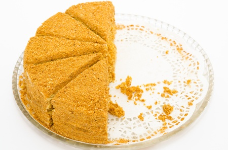 strew: a fresh honey cake - half of pieces are missing Stock Photo