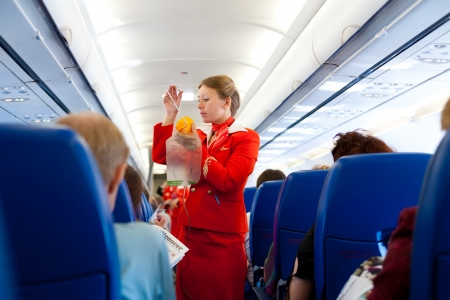 MOSCOW - MAY 28: Unidentified air hostess of Aeroflot shows how to use an oxygen mask on board from Irkutsk to Moscow, May 28, 2011.  報道画像