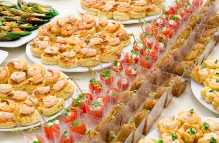 a lot of cold snacks on buffet table, catering photo