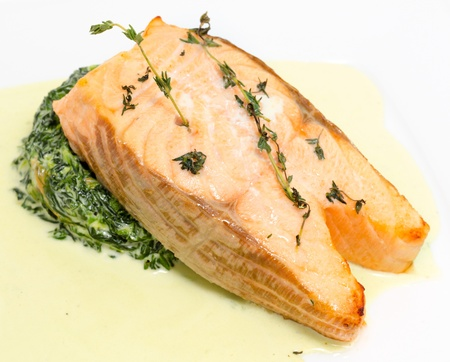 spinage: salmon steak garnished with spinach