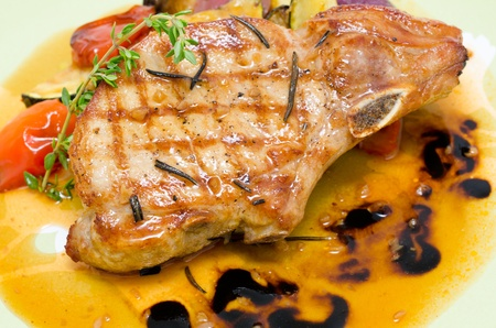 sweet course: grill - pork brisket with vegetables with sour sweet sauce Stock Photo