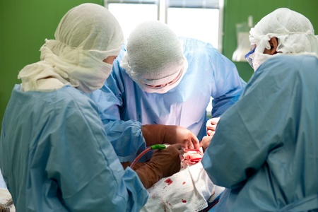 a real surgical operation - three surgeons work Stock Photo - 11930273