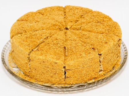a fresh honey cake, cut, on a glass tray Stock Photo