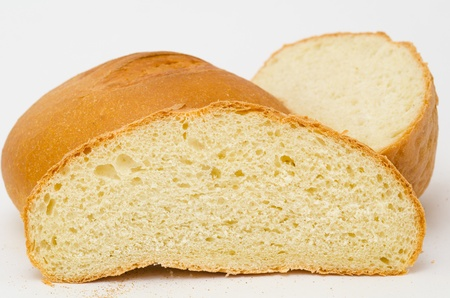 fresh wheat bread - loafs and a round photo