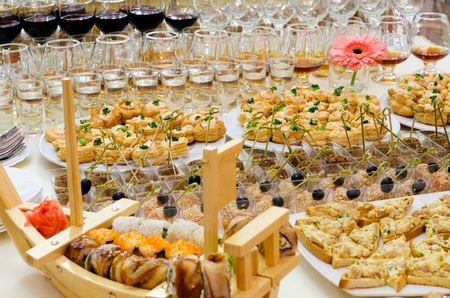 food buffet: a lot of cold snacks and drinks on buffet table, catering Stock Photo
