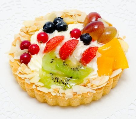cakes and pastries: a short pastry basket filled with cream, fruit and berries