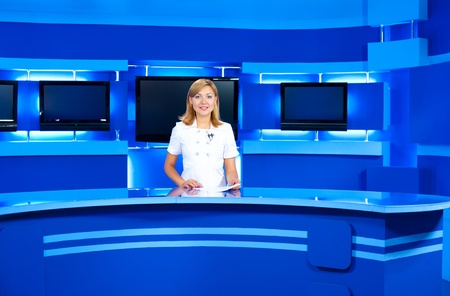 tv reporter: a television announcer at studio during live broadcasting