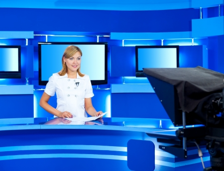 newsreader: a television announcer at studio during live broadcasting