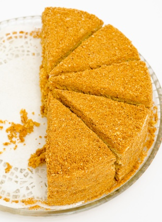 a fresh honey cake - half of pieces are missing Stock Photo - 12115710